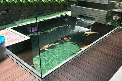 Jasa tukang taman surabaya - Air Terjun Di Kolam Ikan