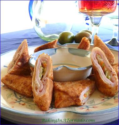 Chipotle Cordon Bleu Egg Rolls, a cordon bleu flavors married with a spicy slaw in a pan fried egg roll. Serve for lunch, dinner or an appetizer | Recipe developed by www.BakingInATornado.com | #recipe #lunch #appetizer