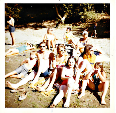 "Lana Thomson, Olga Mejia, Natalie Vasilev, Sean Sarsfield, Frank Storti, Lena Vasilev, Margo Storti, Lisa Storti, and Marie ""Rhea"" Thomson at the Russian River in 1970 or 1971."