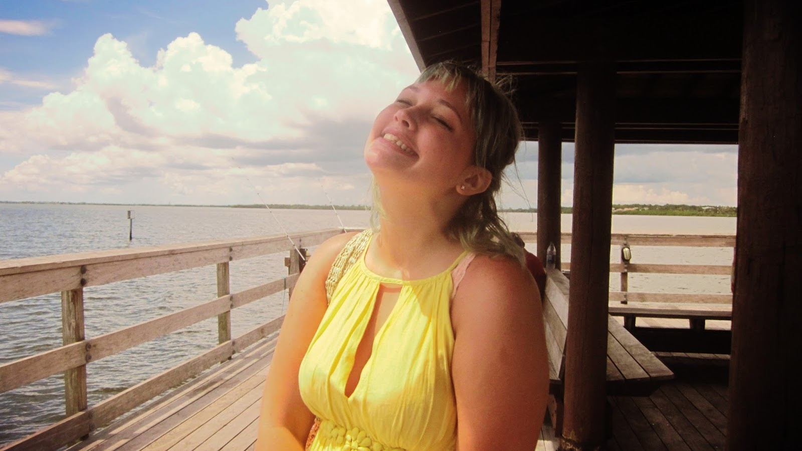 Cute Blue-Haired Girl Smiling on the Docks of Tampa Bay in Safety Harbor, Florida in a Yellow Dress