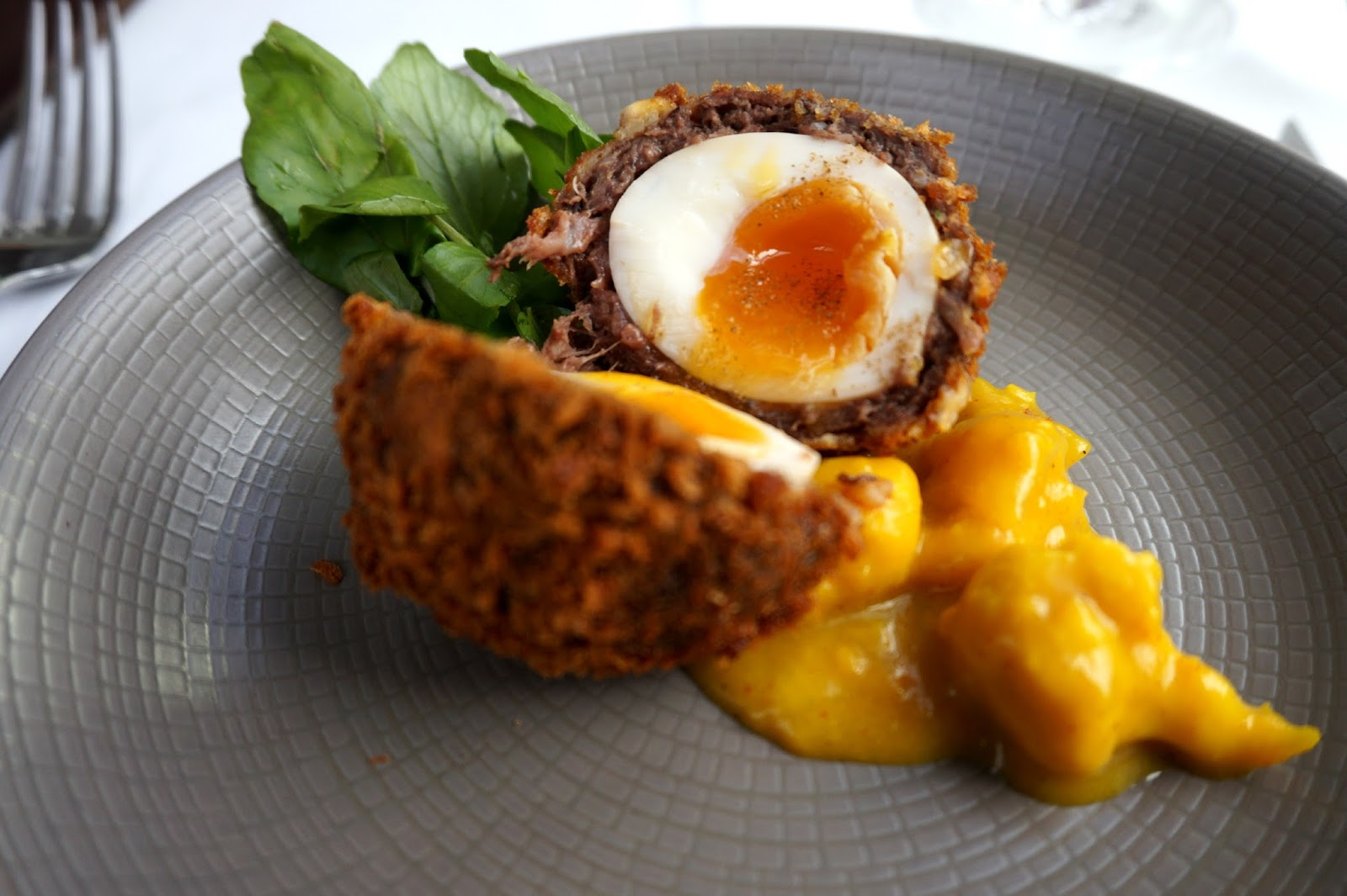 black pudding scotch egg served with piccalilli