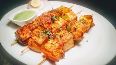 Garnished paneer Tikka using on Tawa or non stick pan for paneer Tikka Recipe