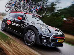 A Mini Cooper with Giant Bikes.