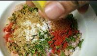 Adding lemon juice over spied ground chicken for chicken seekh kabab recipe
