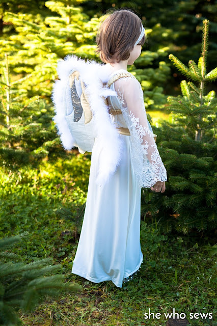 Feather wings and white dress