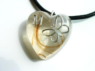 Hair and butterfly pendant