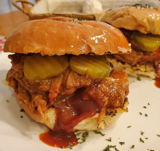 this is a barbecued sandwich with pulled pork, pickles and Jack Daniels Barbecued homemade sauce recipe