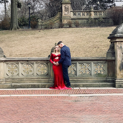 Well-dressed couple posing for photo outdoors