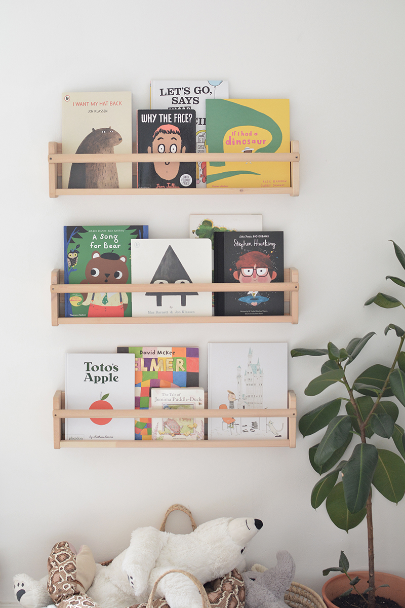 neutral nursery bookshelves with colourful books