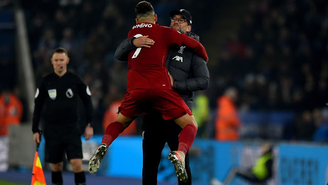 Roberto Firmino enjoys that winning feeling and jumps for joy into the arms of Jurgen Klopp after Liverpool thrash Leicester City 4-0 at the King power stadium