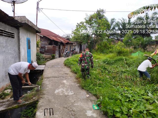 Ditengah Pandemi, Personel Jajaran Kodim 0208/Asahan Ajak Warga Laksanakan Gotong-royong