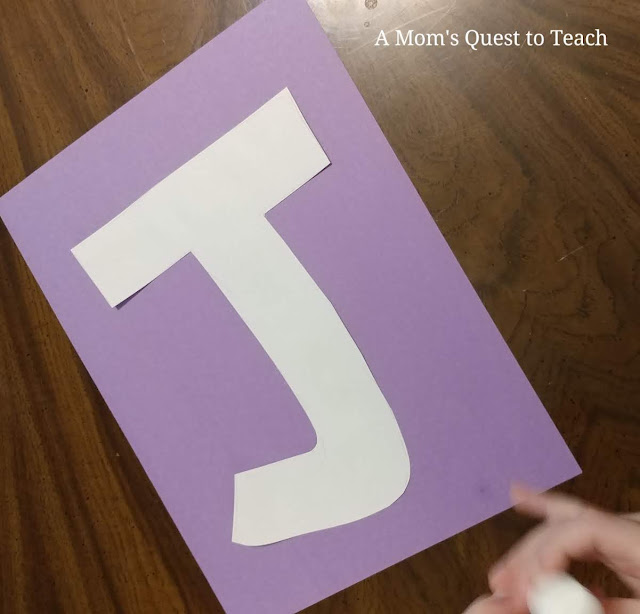 letter J made of construction paper glued onto purple construction paper