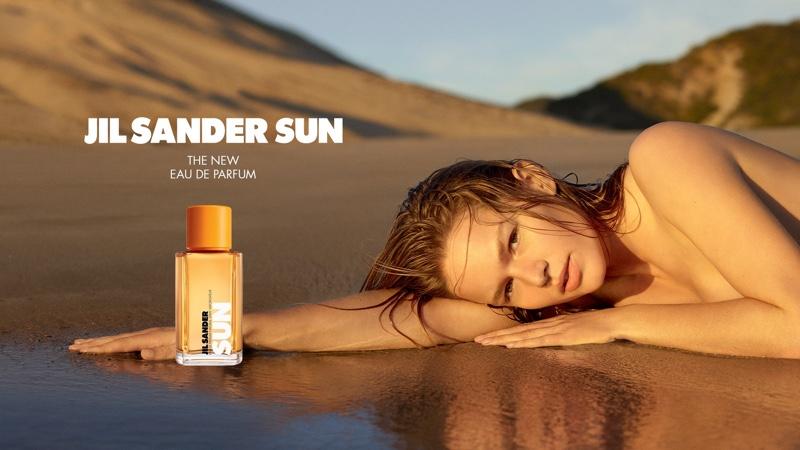 Anna Ewers Lies On the Beach for Jil Sander 'Sun' Fragrance Ad