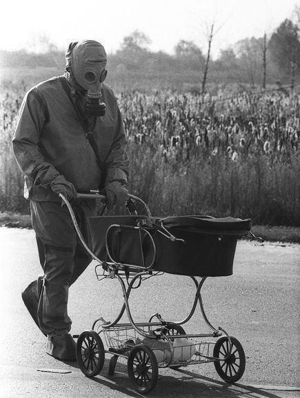 Chernobyl Liquidator recovers a baby abandoned in a village home during the evacuation, 1986
