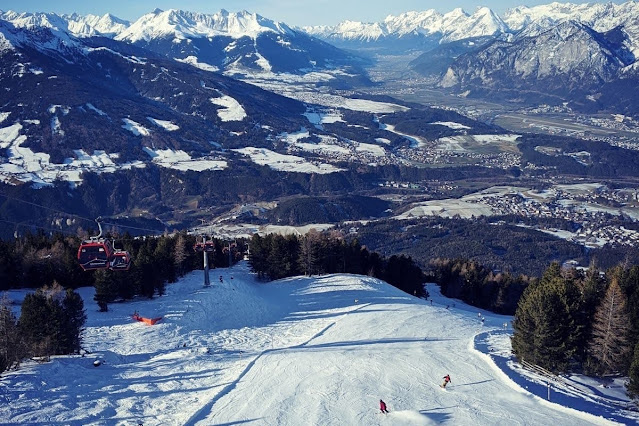 Things to do in Innsbruck in winter: Watch the skiers at Things to do in Innsbruck in winter: lunch at Schutzhaus on Patscherkofel