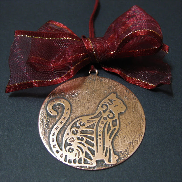 Salt water etched copper cat Victorian style Christmas tree decoration.  Etched using vinyl resists cut by Silhouette Cameo.  Tutorial by Nadine Muir for Silhouette UK Blog