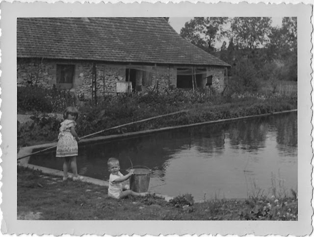 Dawn and Les Hoover fishing in the swimming pool at the Moulin de Humeau in the 1950s. Indre et Loire, France.