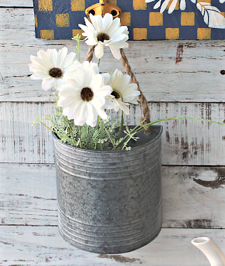 Photo of a galavanized metal wall container/planter from Hobby Lobby.