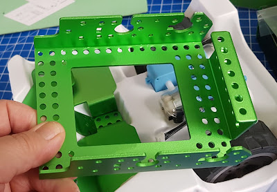 Large part of Robobloq Q-Scout body and frame is made from green stained metal