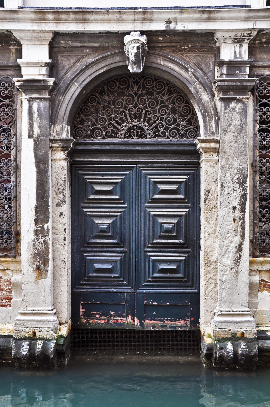 A door leading to a canal in Venice