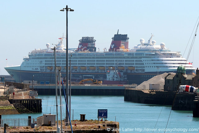 Disney Cruise Line's passenger ship arrival during Coronavirus lock down restrictions May 19th, 2020. Vessel berthed at Cruise Terminalo One (CT1) on Admiralty Pier in Dover Western Docks Revival area of the harbour. Old Customs House shown. Viewfrom A20 Limekiln Street.