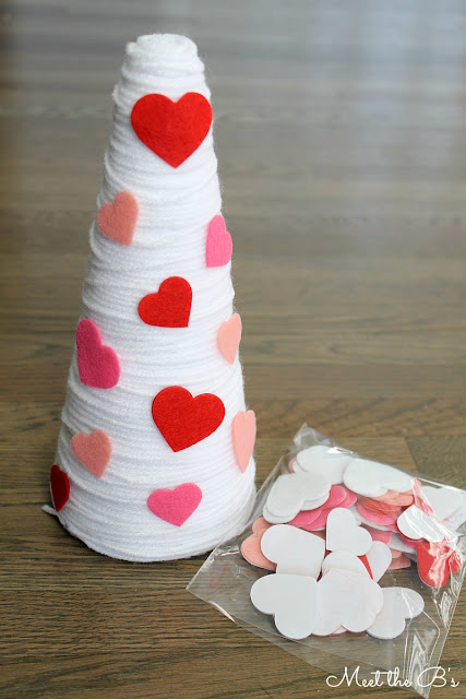 How to make easy DIY Valentine's Day decor made from yarn and styrofoam cones.