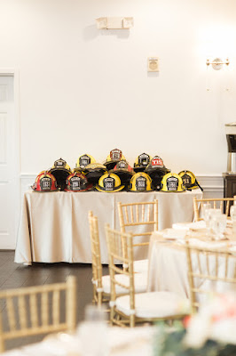 firefighters helmets at wedding reception