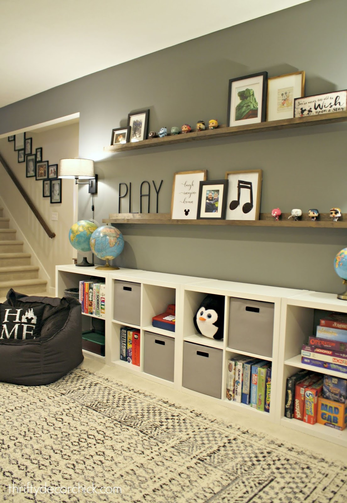 Create a wall of toy storage and picture ledges