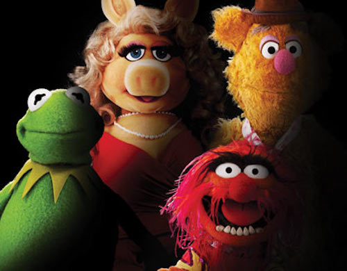 Kermit the Frog, Miss Piggy, Fozzie Bear, and Animal all facing the viewer, severely lit from one side, the other side of their faces in shadow