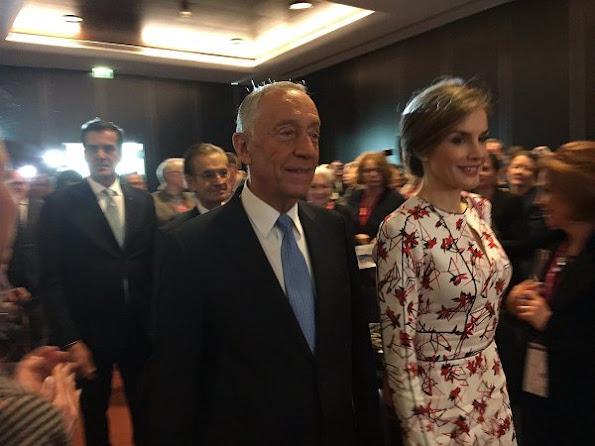Queen Letizia wore Zara wool coat in red, Carolina Herrera Floral Dress and Lodi Saray Pumps at European Conference in Porto