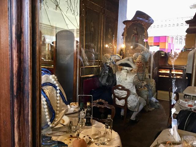 Through the window of Caffè Florian, Venice Carnival - Photo: Cat Bauer