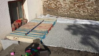mise-niveau-palettes-sol-terre-terrain