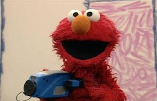 Elmo has a home video. Elmo makes a video with his camera. Elmo's World Balls Home Video
