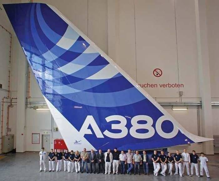 Workers lined up at the tail of an Airbus A380