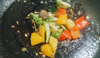 Sauteing exotic vegetables with garlic for White sauce vegetable pasta recipe
