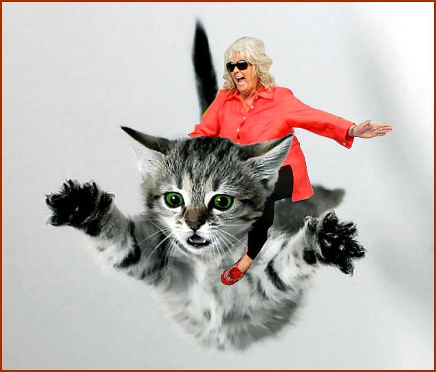 Crazy Paula Deen riding a GIANT flying kitten