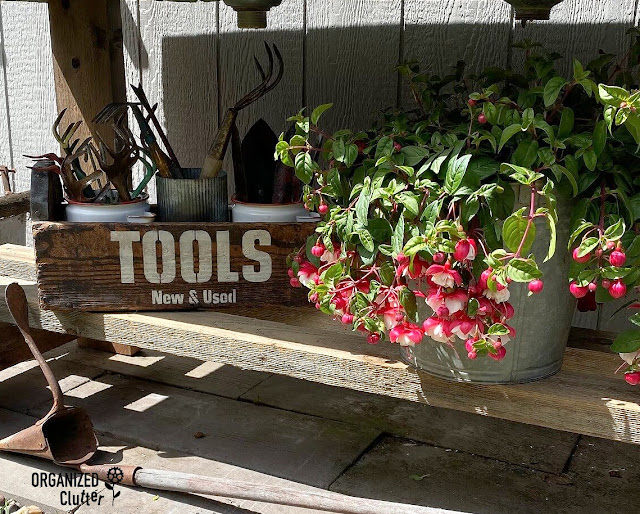 Photo of vintage toolbox with garden tools stencil and filled with vintage tools