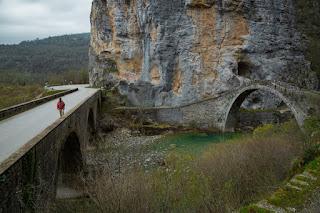 Two stone bridges beside a cliff face