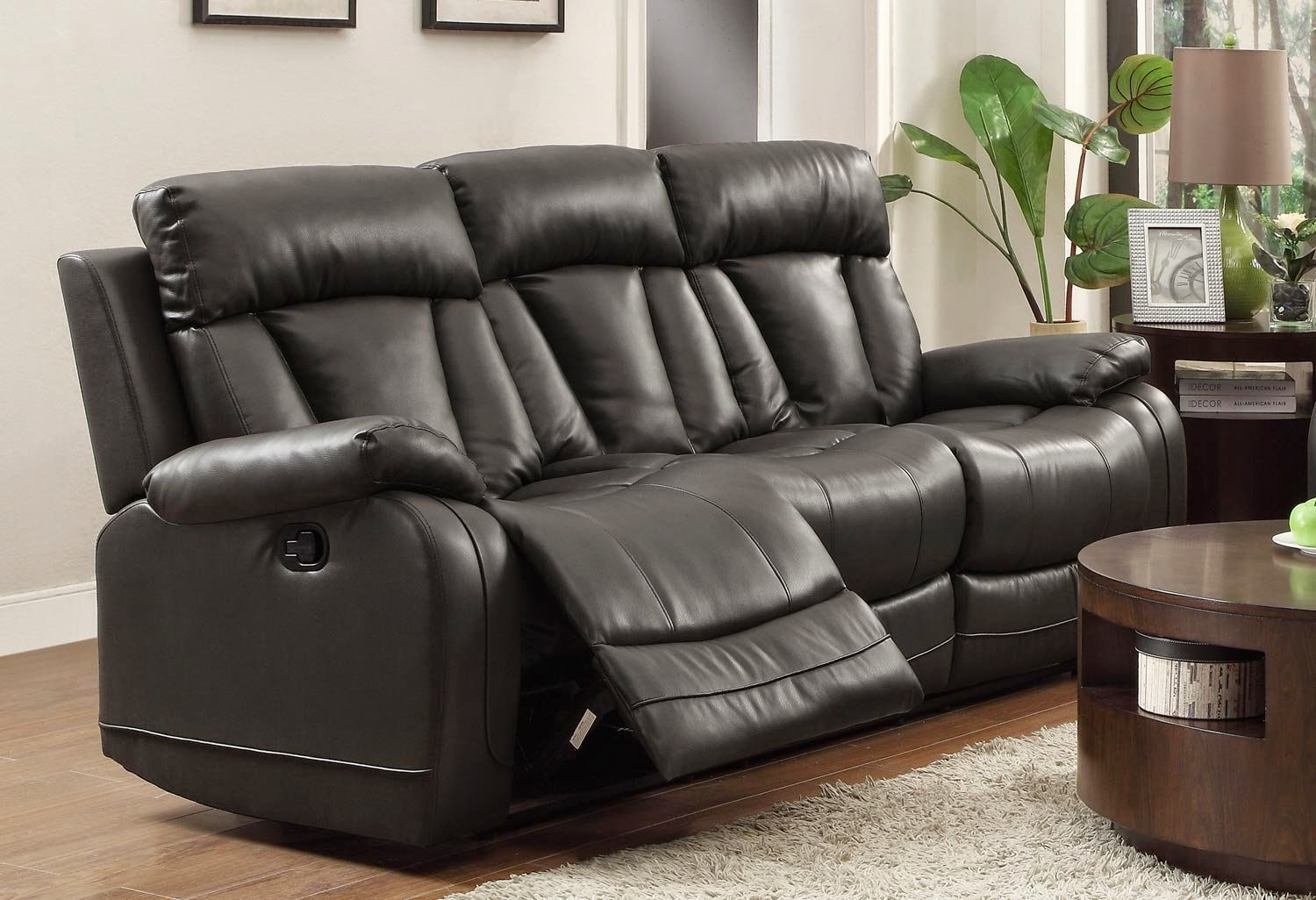 the best reclining sofa reviews rotunda black faux. Black Bedroom Furniture Sets. Home Design Ideas