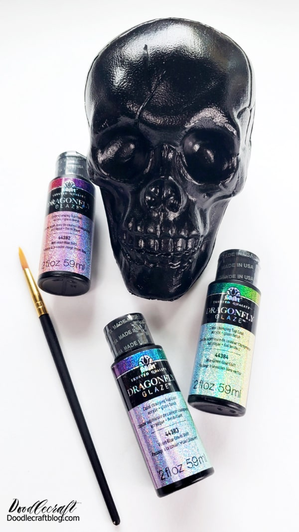 Step 2: Make it Shimmer! After the skull has dried, it's time to make it shimmer. Use the Dragonfly Glaze and paint the variety of colors on the skull in small patches, alternating the colors. This will give it the iridescent effect with the micro glitter shimmer.