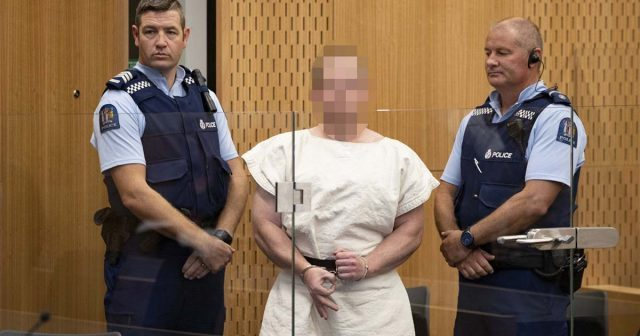 Image Attribute: Brandon Tarrant, 28, appears in court in New Zealand on Saturday after police apprehended a car he was traveling in shortly after the Christchurch attack.