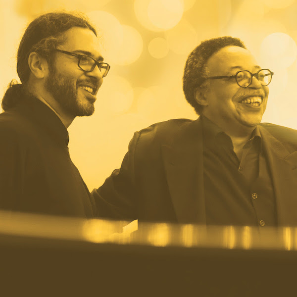 George Elliott Clarke (right) and musician Tim Crofts (left).