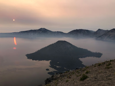 smokey air at sunrise over Crater Lake