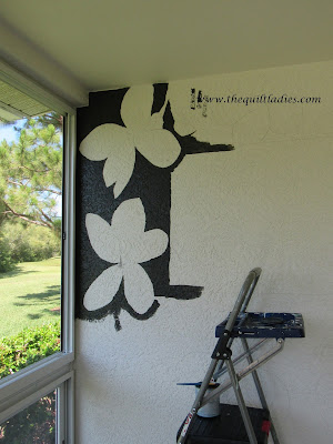 Hand painted flowers on a stucco wall