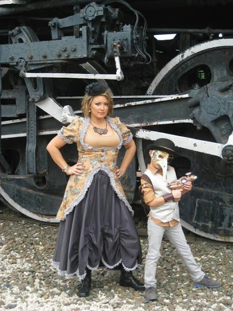 Steampunk mother with her child. Mom and kid are dressed in victorian steampunk costumes with masks and weapons