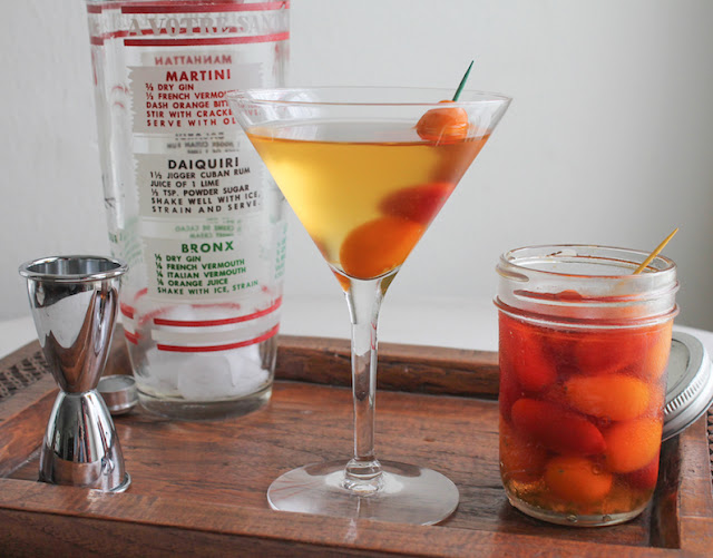 Food Lust People Love: A martini with a delicious difference, this spicy pickled tomato dirty martini is garnished with easy-to-make quick pickled grape tomatoes. The pickling liquid with rice vinegar and fish sauce also has a welcome hot kick from minced fresh chili pepper.