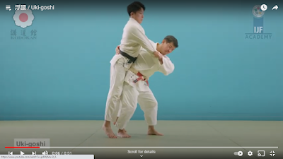 Picture of a Judoka being Tori Breaking Uke's balance as he performs Uki Goshi