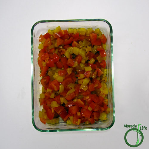 Morsels of Life - Feta Topped Salmon Step 4 - Combine tomatoes and roasted pepper and put in an oven safe container.