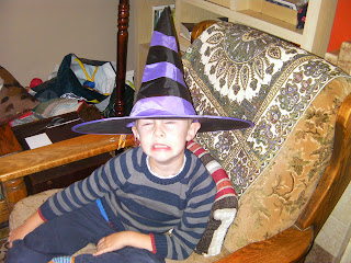 boy in a witches hat