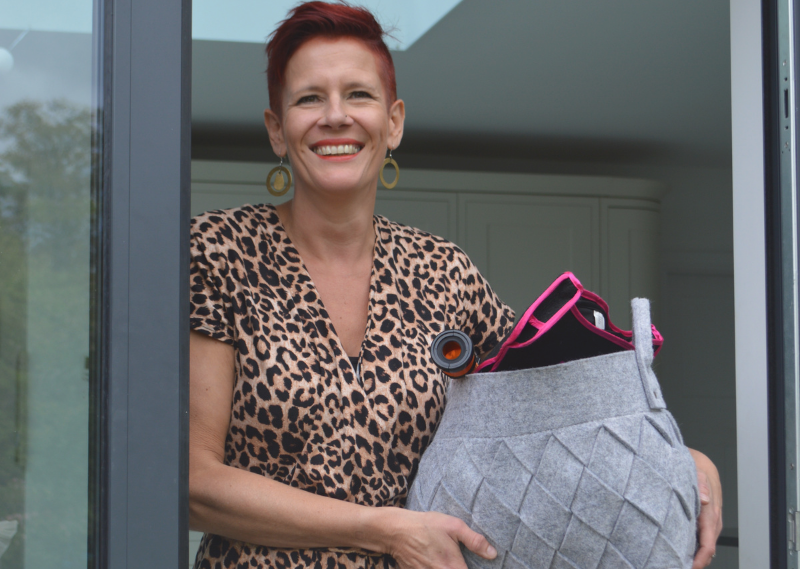 Roxy holding a decluttered box in a post about how to effectively declutter and organise your home.